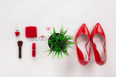 Accessories : Flatlay of white background with high heels and makeup accessories