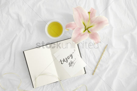 Flat : Flatlay of white cloth background with lilies