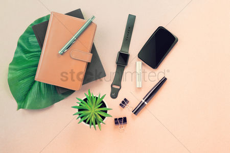 Notebook : Flatlay with beige background and various accesories