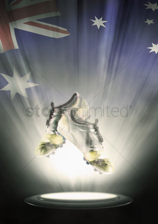 Nationality : Football cleats with australia flag backdrop
