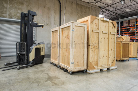 Forklift : Forklift and wooden containers in manufacturing industry