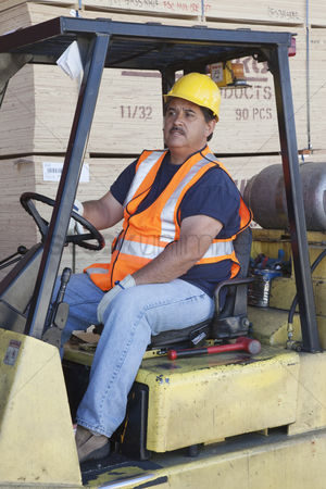 Forklift : Forklift driver driving in warehouse