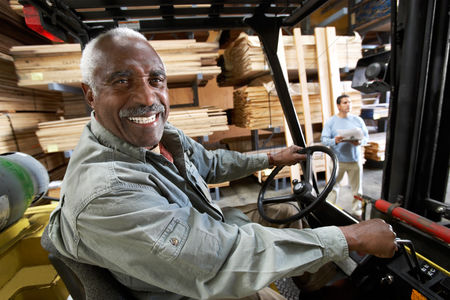 Forklift : Forklift driver on forklift in lumber warehouse