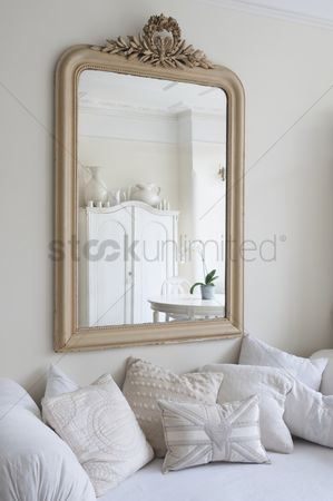 England : Framed mirror above daybed with cushions