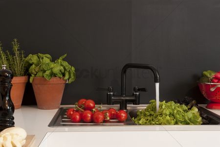 Black background : Fresh salad ingredients on kitchen sink