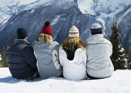 Adulthood : Friends sitting together  enjoying winter scenery