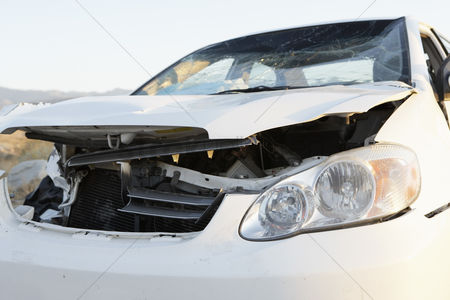 Transportation : Front end of wrecked car on desert highway