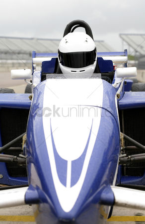 Spirit : Front view of a formula one driver in racing car