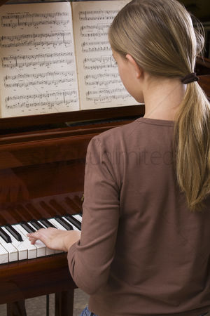 Ponytail : Girl  13-15  playing piano