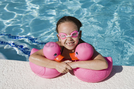 Toy : Girl at pool side holding pink rubber ducks