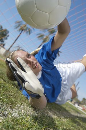 Match : Girl catching soccer ball