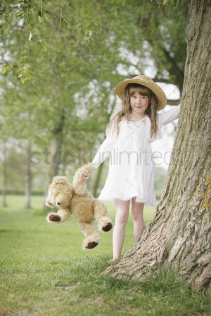 Gladness : Girl going for a walk with teddy bear