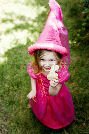 Celebrating : Girl in a pink princess costume