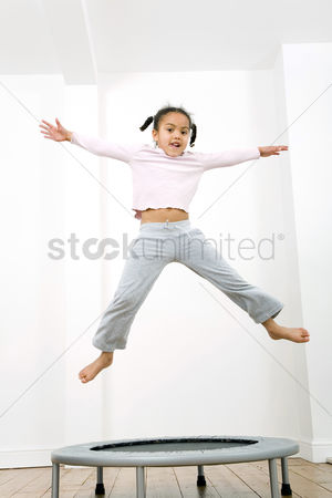 Lively : Girl jumping on trampoline