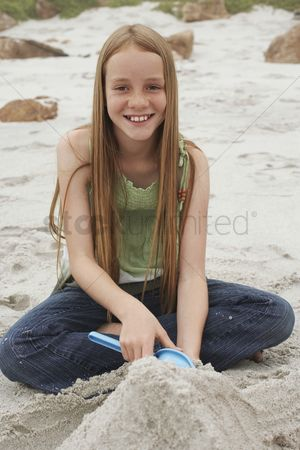Gladness : Girl playing on beach