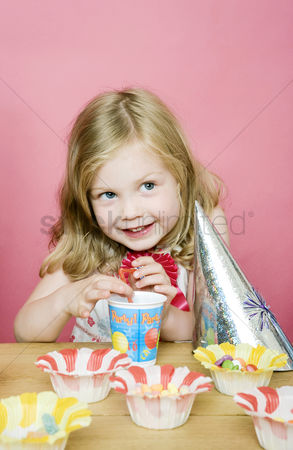 Celebrating : Girl playing with drinking straw