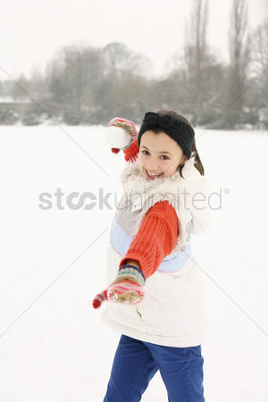 Gladness : Girl playing with snowball
