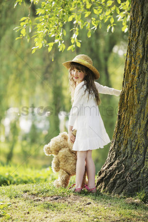 Trees : Girl playing with teddy bear