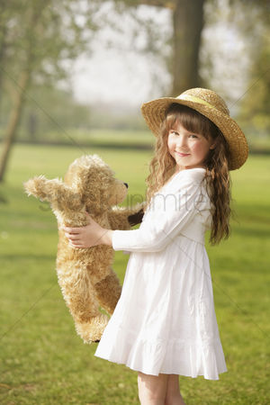 Gladness : Girl playing with teddy bear