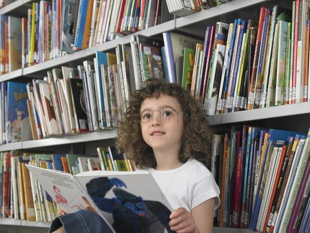 Curly hair : Girl reading book in library