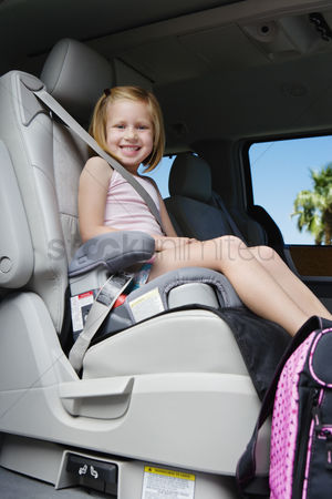 Schoolkids : Girl riding in booster seat