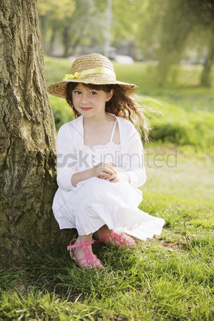 Gladness : Girl sitting by the tree