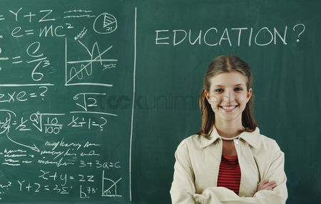 Learning : Girl standing in front of the blackboard