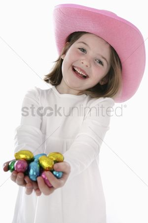 Easter : Girl with chocolate eggs