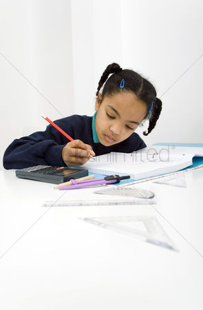 Pupil : Girl writing on paper