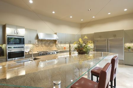 Spacious : Glass topped kitchen surface with stainless steel fitted units