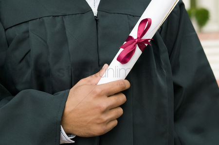 University : Graduate holding diploma mid section