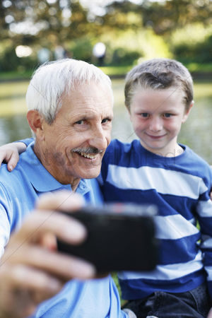 Young boy : Grandfather and grandson taking picture together