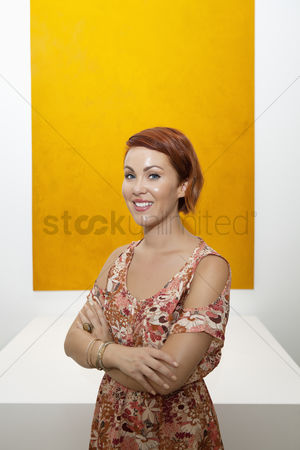 Interior background : Half-length portrait of young woman in front of yellow painting