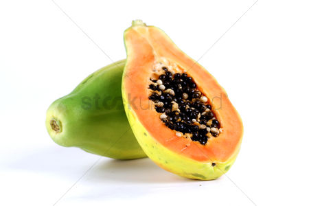 Black background : Halved papaya on white background