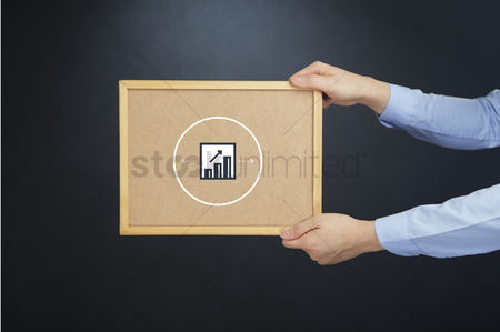 Cork board : Hand holding a board with bar graph concept