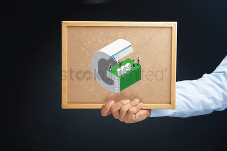 Cork board : Hand holding a board with isometric alphabet g
