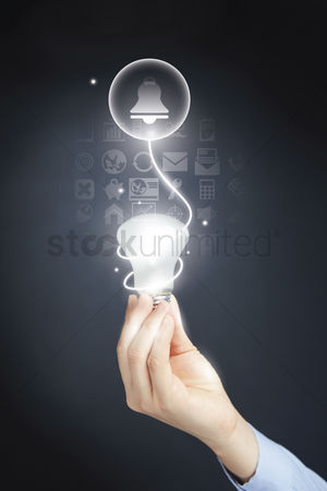 Alert : Hand holding a light bulb with notification concept