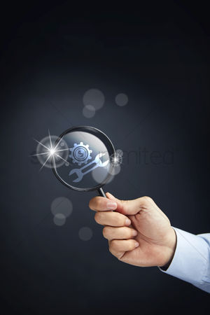 Fix : Hand holding magnifying glass with service warranty icon