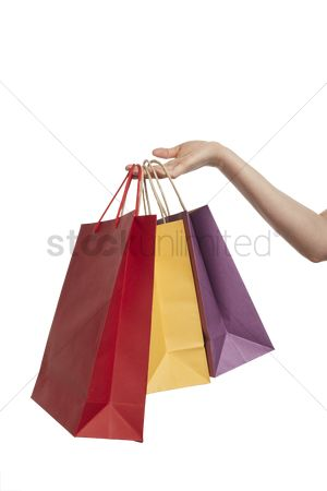 Shopping background : Hand holding shopping bags