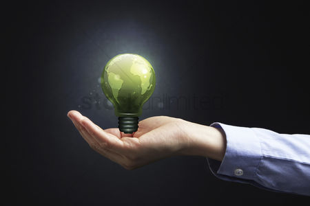 Earth  graphic vector : Hand presenting a light bulb with earth