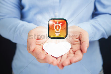 Heart shapes : Hand presenting business idea button concept