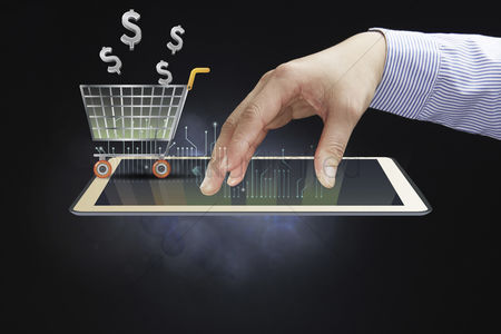 Shopping cart : Hand presenting e-commerce concept on tablet pc