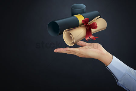 Proud : Hand presenting graduation scroll