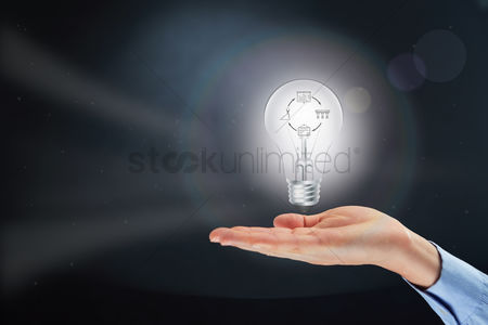 Steps : Hand presenting light bulb with employee development concept