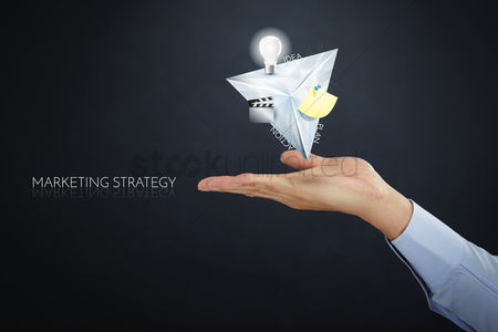 Notepad : Hand presenting marketing strategy concept