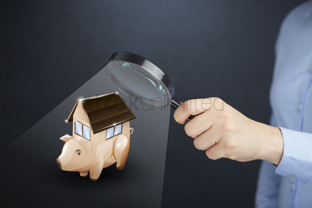 Magnifying glass : Hand presenting mortgage savings concept