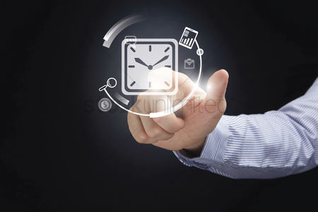 Media : Hand presenting time management concept