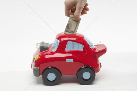 Body : Hand putting money in car shaped piggy bank