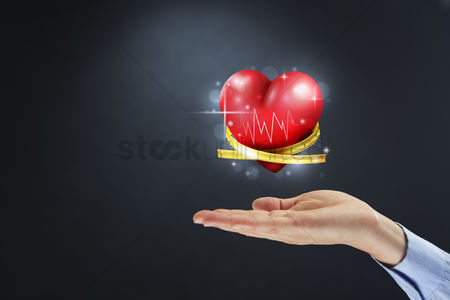Heart shapes : Hand showing a cardiogram heart