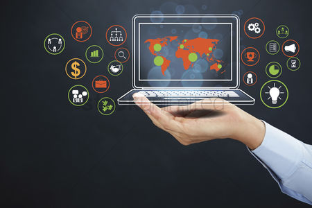 Media : Hand showing laptop with business icons